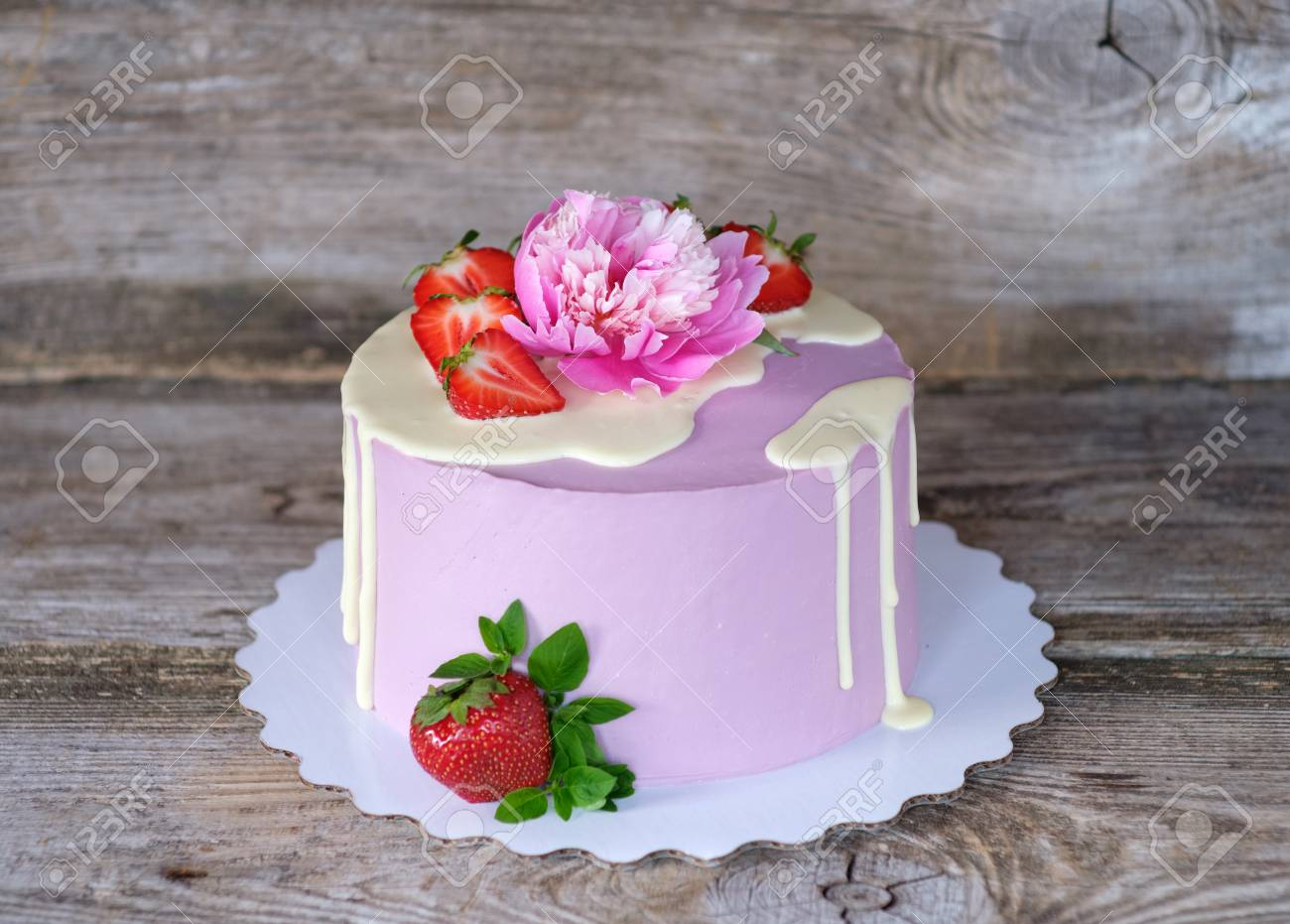 Beautiful Homemade Cake With Purple Cheese Cream Decorated Live Pink Peony And Strawberry Berries