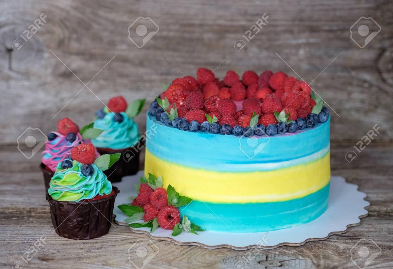 Beautiful Homemade Cake With Yellow And Blue Cream Decorated Raspberries Blueberries