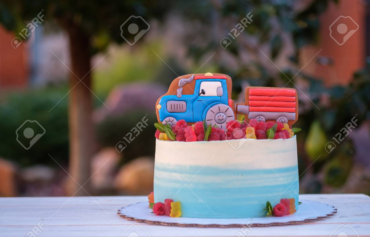 Beautiful Birthday Cake For Baby With Funny Blue Tractor Stock Photo