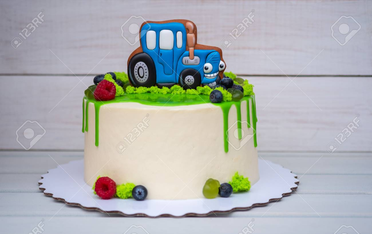 Birthday Cake For A Child With Toy Tractor And Fresh Berries Standard Bild