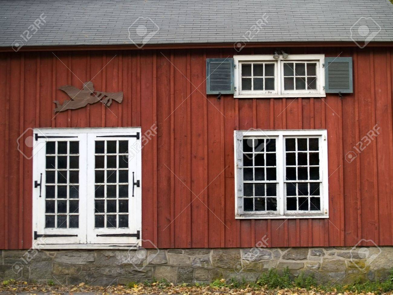 A colorful side of a rural country building depicting antique windows and  doors along with nice - A Colorful Side Of A Rural Country Building Depicting Antique