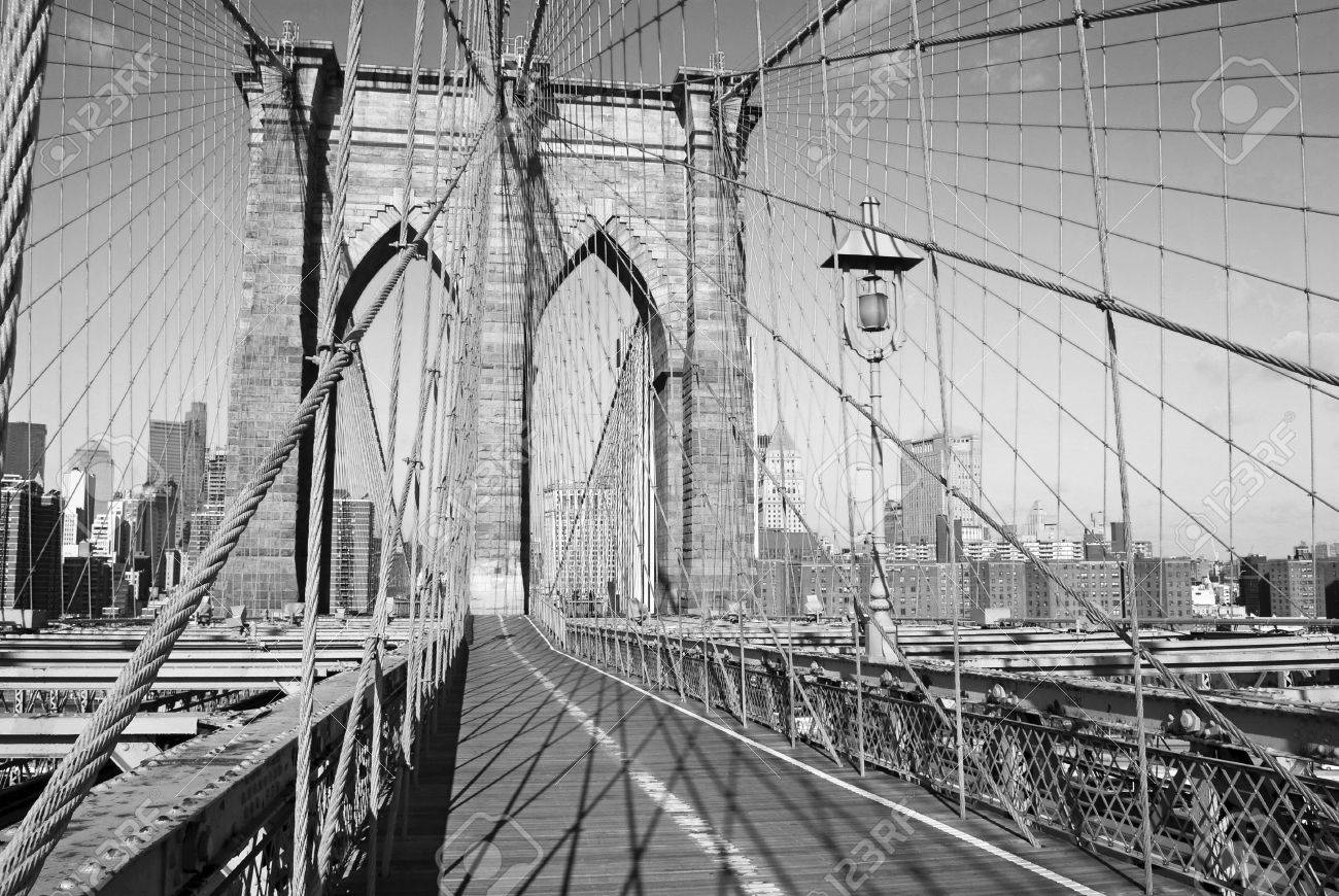 A black and white view of the pedestrian walkway on the Brooklyn Bridge. Stock Photo - 4493158