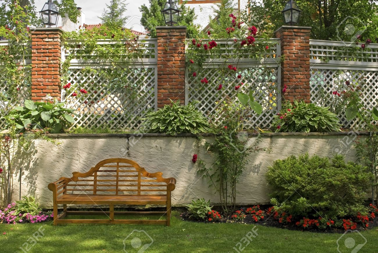 Delicieux A Garden Wall With A Trellis And Red Rose Bushes. Stock Photo   7756032