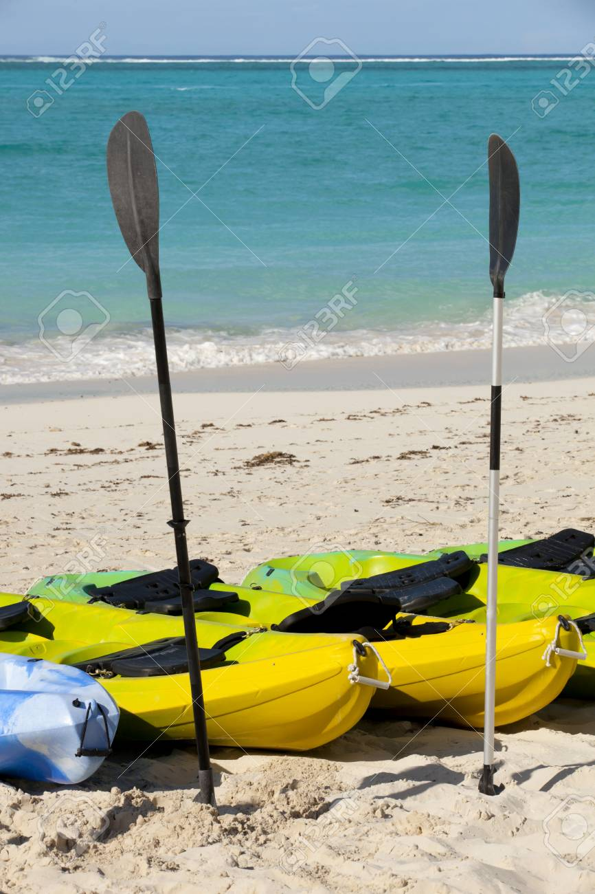 Kayaks and sailboat on a tropical island beach in the caribbean Stock Photo - 12193759