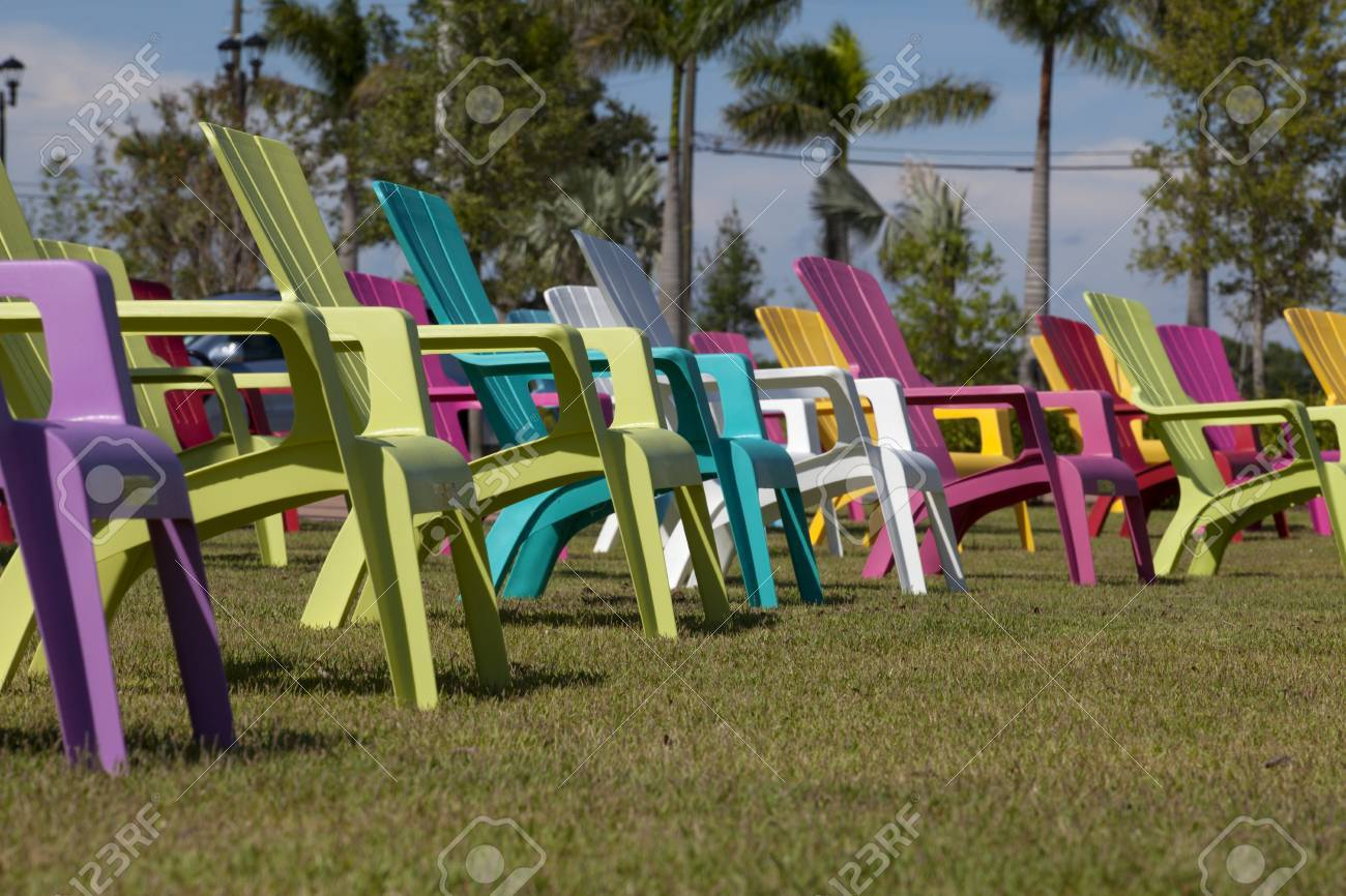 Colorful Plastic Adirondack Chairs In A Park Stock Photo   25917138