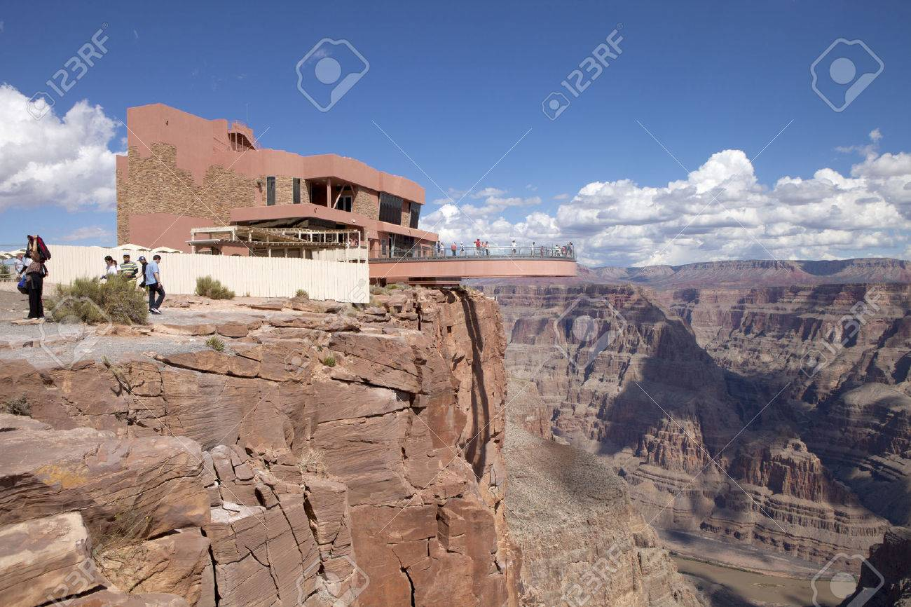 Tourist Enjoying The View Of The West Rim Of The Grand Canyon