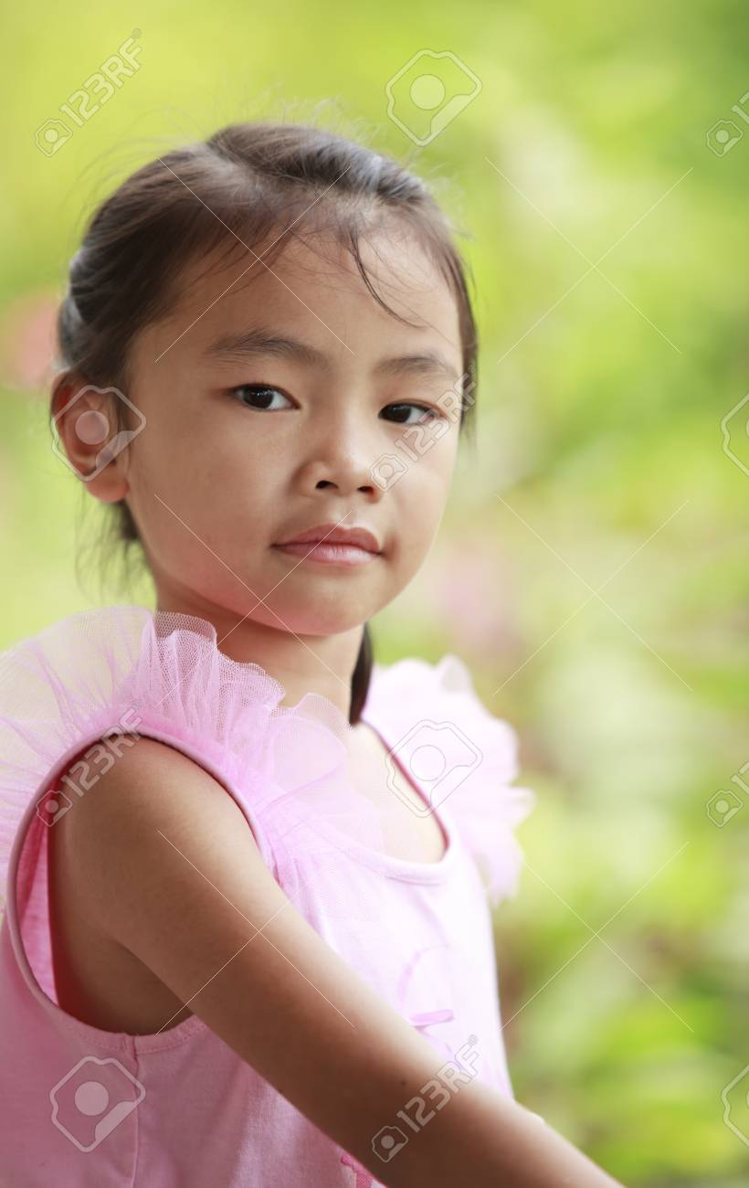 Asian cute children in green nature backgrond Stock Photo - 13050398