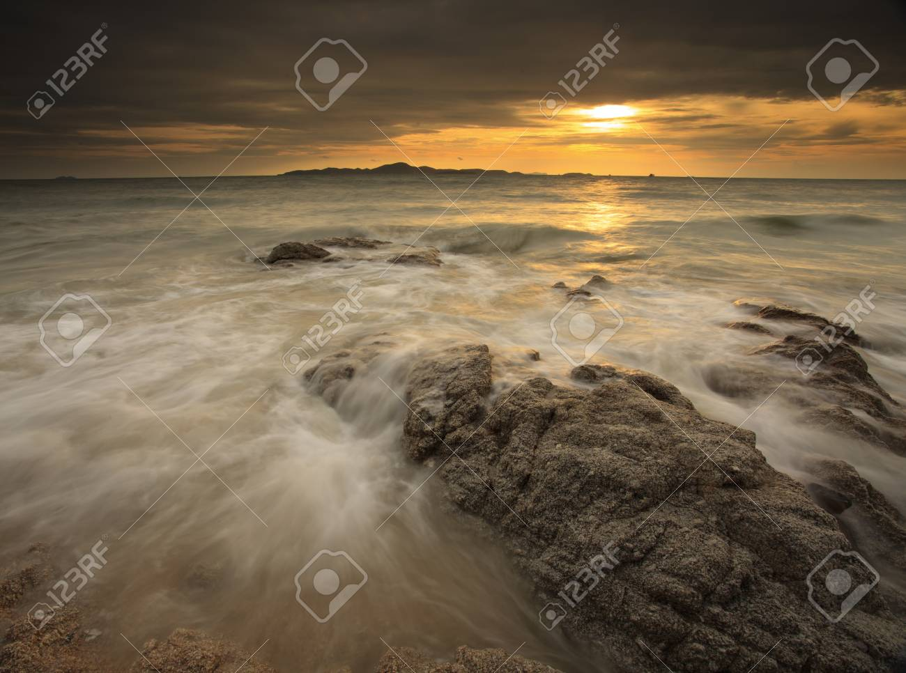 Big wave and the rock with sunset sky at Pattayabeach, Thailand Stock Photo - 13497704