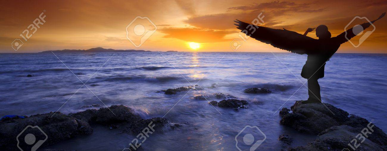 Angel lady with beautiful sunset and sea scene. Stock Photo - 13643765