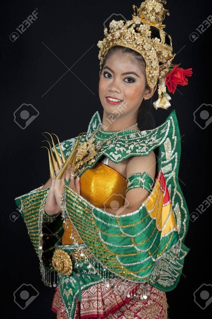Portrait of Thai young lady in an ancient Thailand dance wea with isolated  background. Stock Photo - 14539164