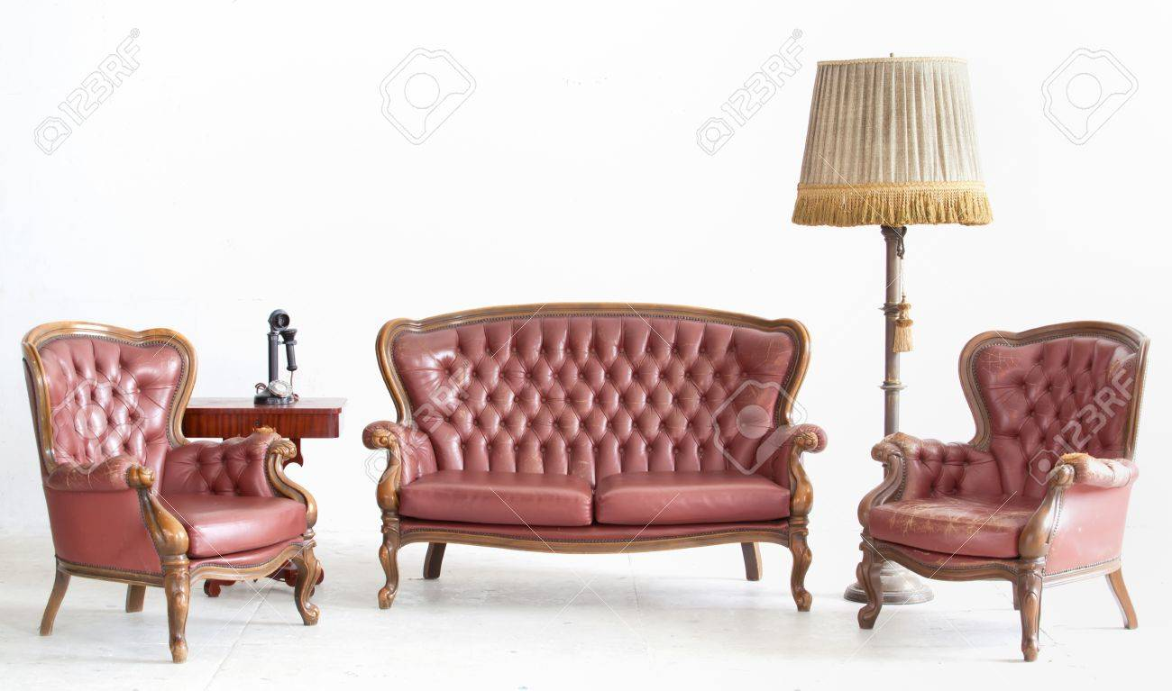 Ancient Leather Sofa With Lamp And Telephone In White Room Stock ...