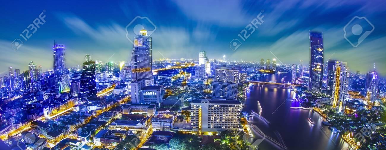 Bangkok city at twilight whit express way and cho pra-ya river, Thailand. Stock Photo - 18581271