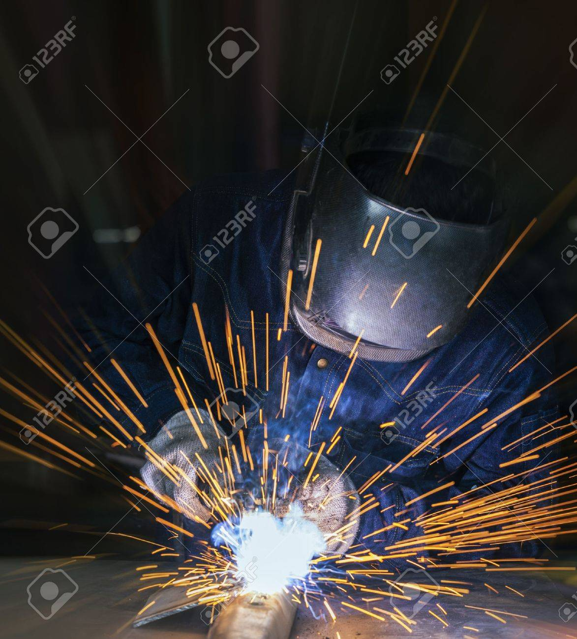 Worker welding the steel part by manual Stock Photo - 21216661