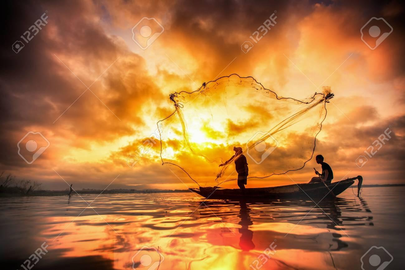 Fisherman of Bangpra Lake in action when fishing, Thailand - 28552858