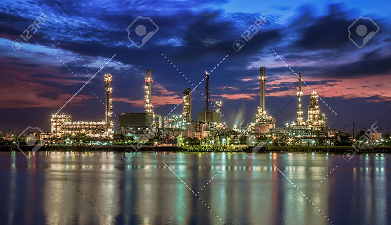 petrochemical plant in night time with reflection over the river Standard-Bild - 30999910