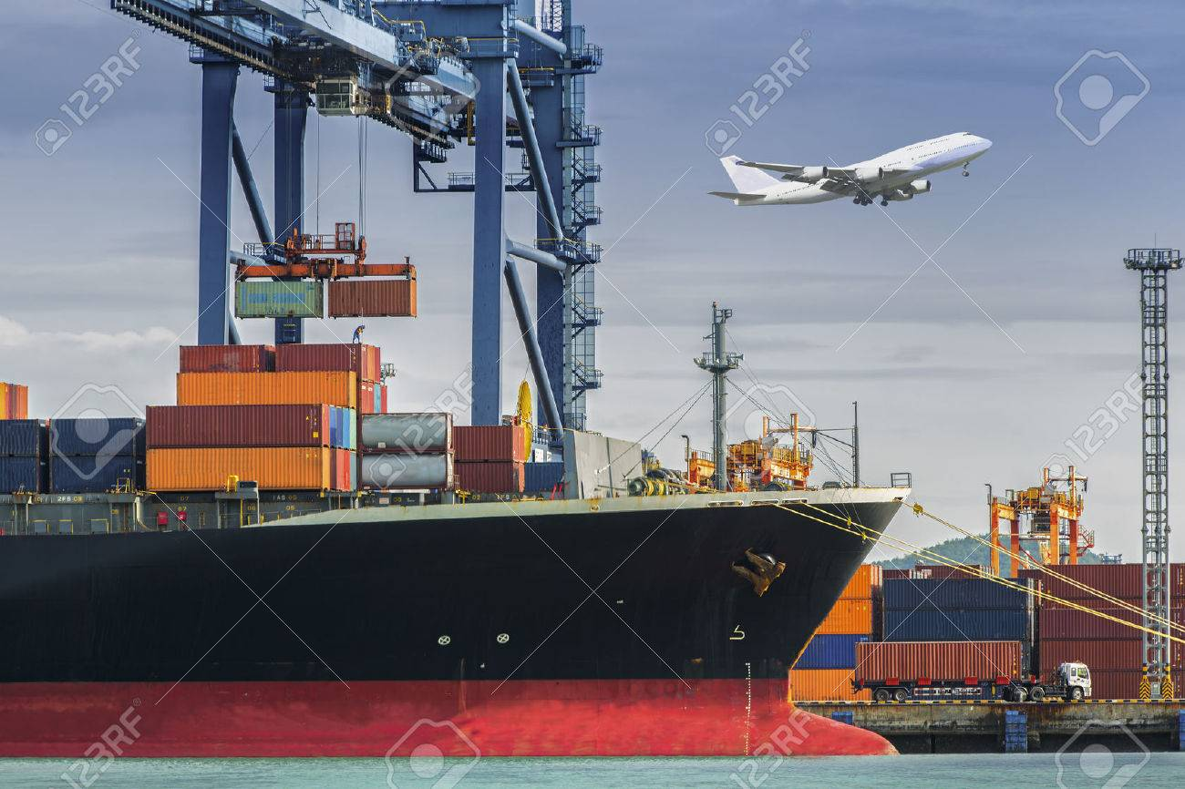 Container Cargo freight ship with working crane loading bridge in shipyard at dusk for Logistic Import Export background Standard-Bild - 31342242
