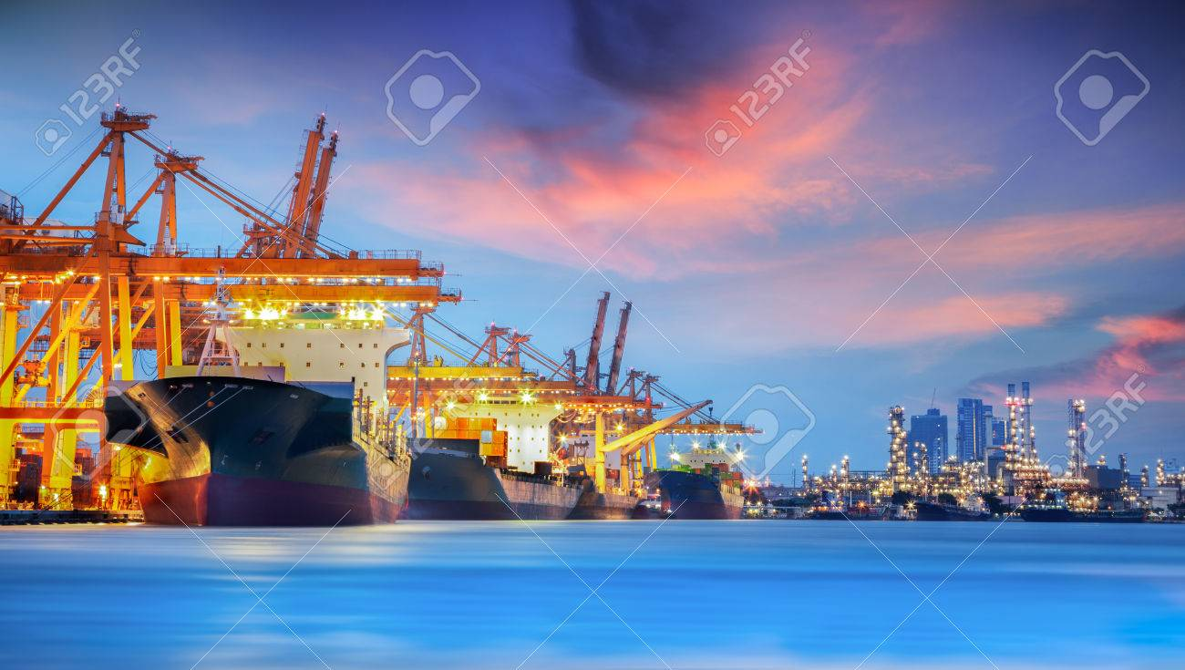 Container Cargo freight ship with working crane bridge in shipyard at dusk for Logistic Import Export background Standard-Bild - 31721432