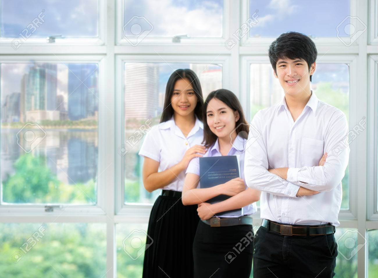 Asia students read in Library with uniform Standard-Bild - 33747898