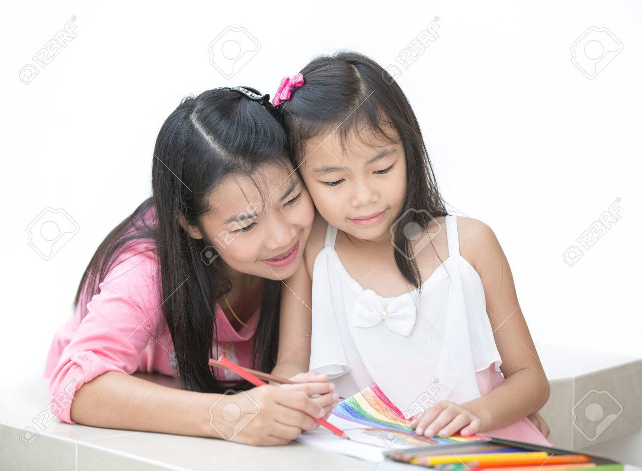 Mon and girl drawing a home work Standard-Bild - 34219153