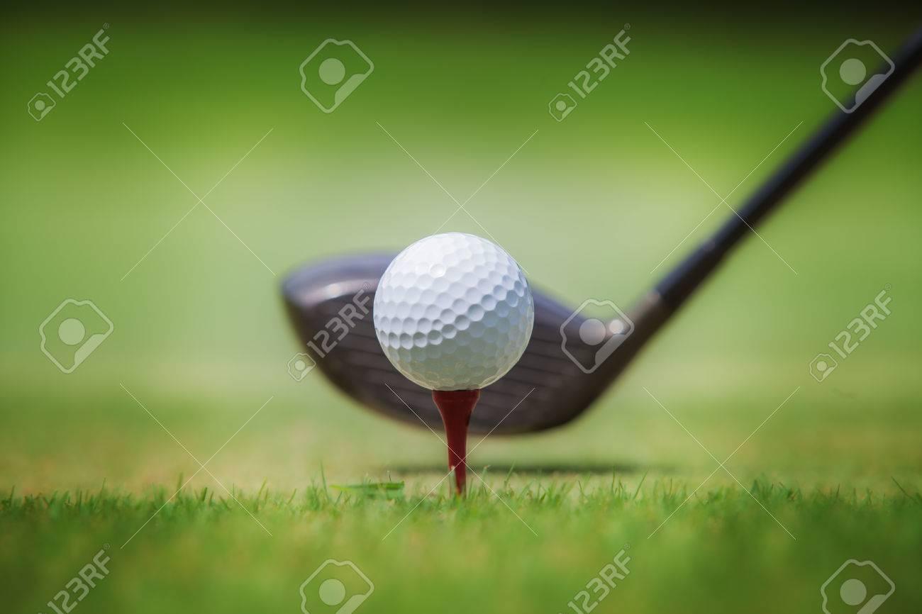 Golf club and ball in grass Standard-Bild - 38178297