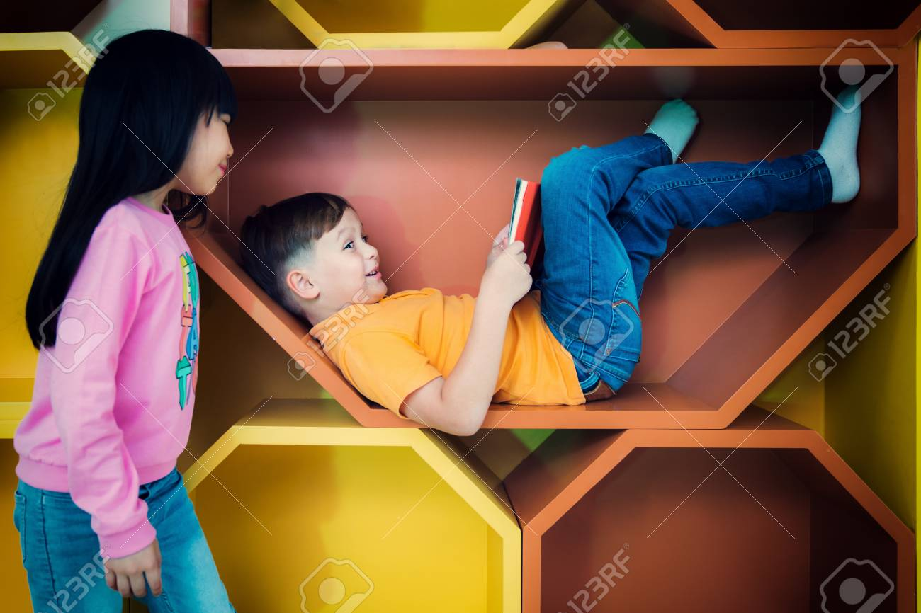 A boy sleep and read a magazine in library in an international