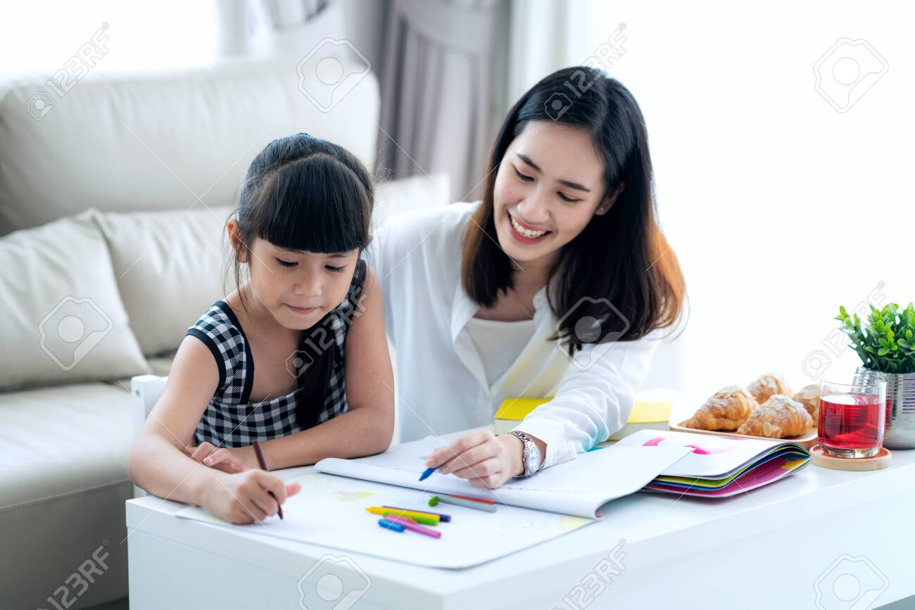 Mother teach Asian preschool student do homework by reawing by a color, this image can use for girl, study, school,mother, teacher, kid, student and education concept - 131788511