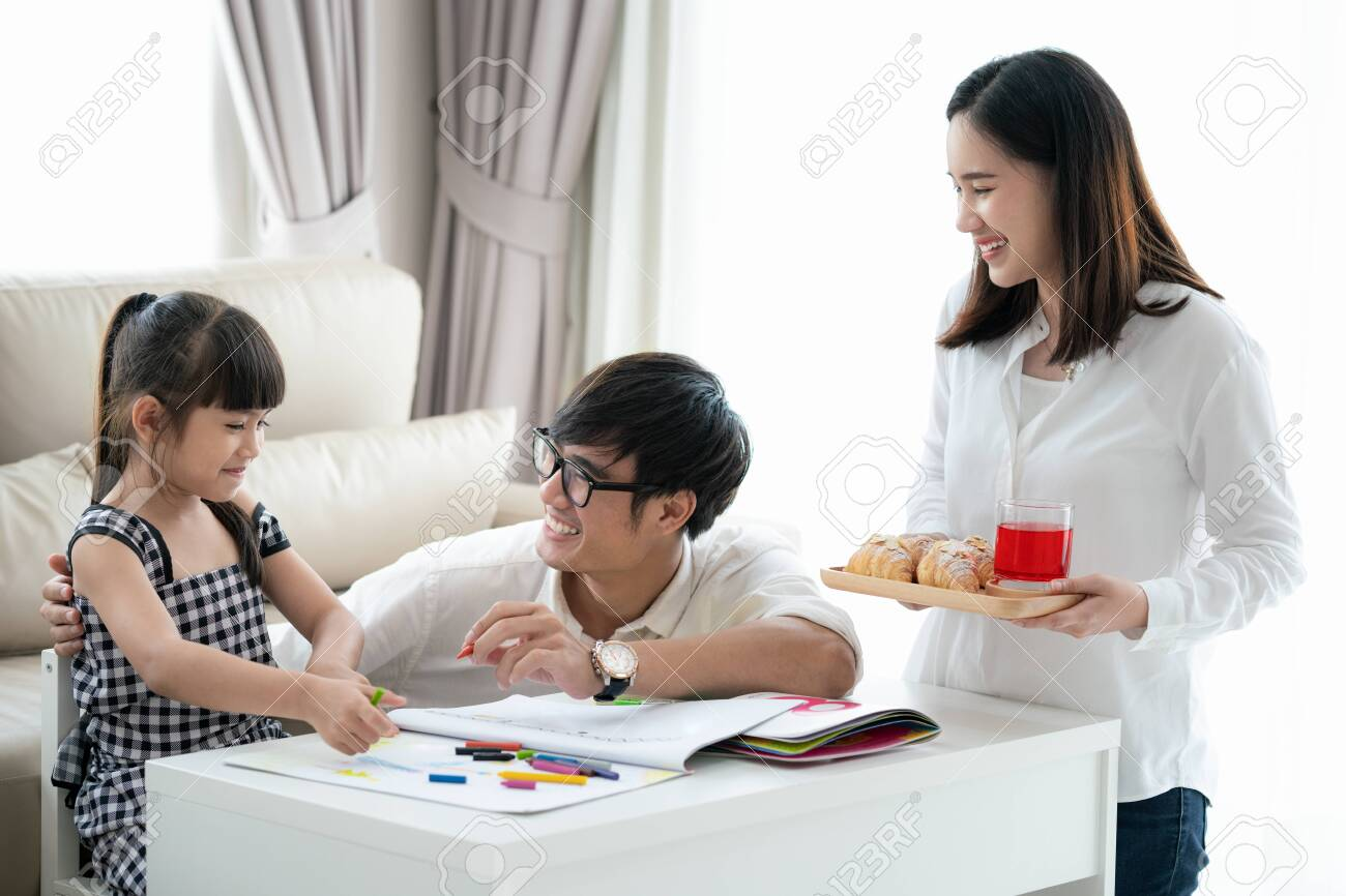 Asian family do homework together in living room, this picture can use for education, student, father, mother and home concept - 132919087