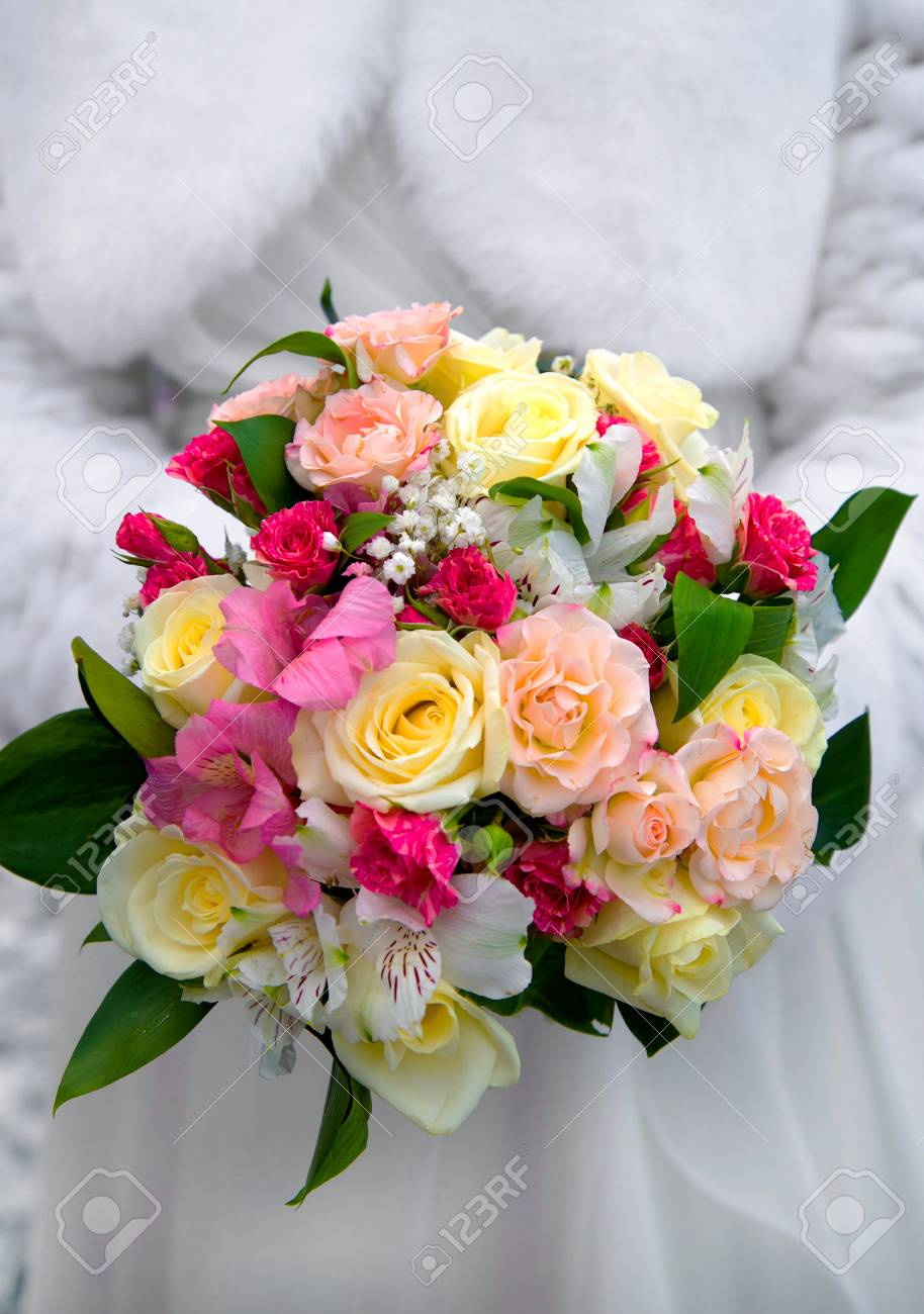 Beautiful Wedding Bouquet Of Pink White And Cream Flowers Held