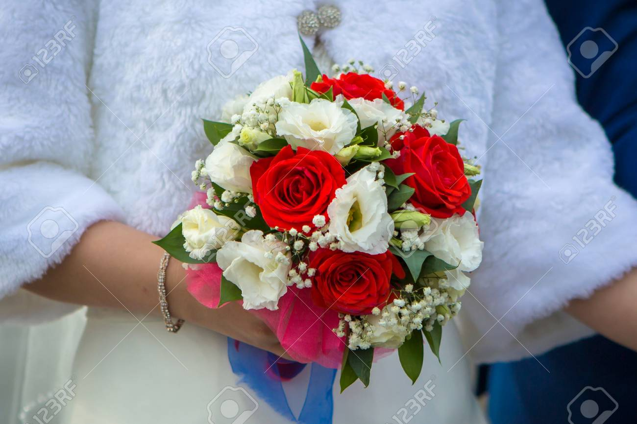 Beautiful Wedding Bouquet Of Red White Flowers Held By The Bride