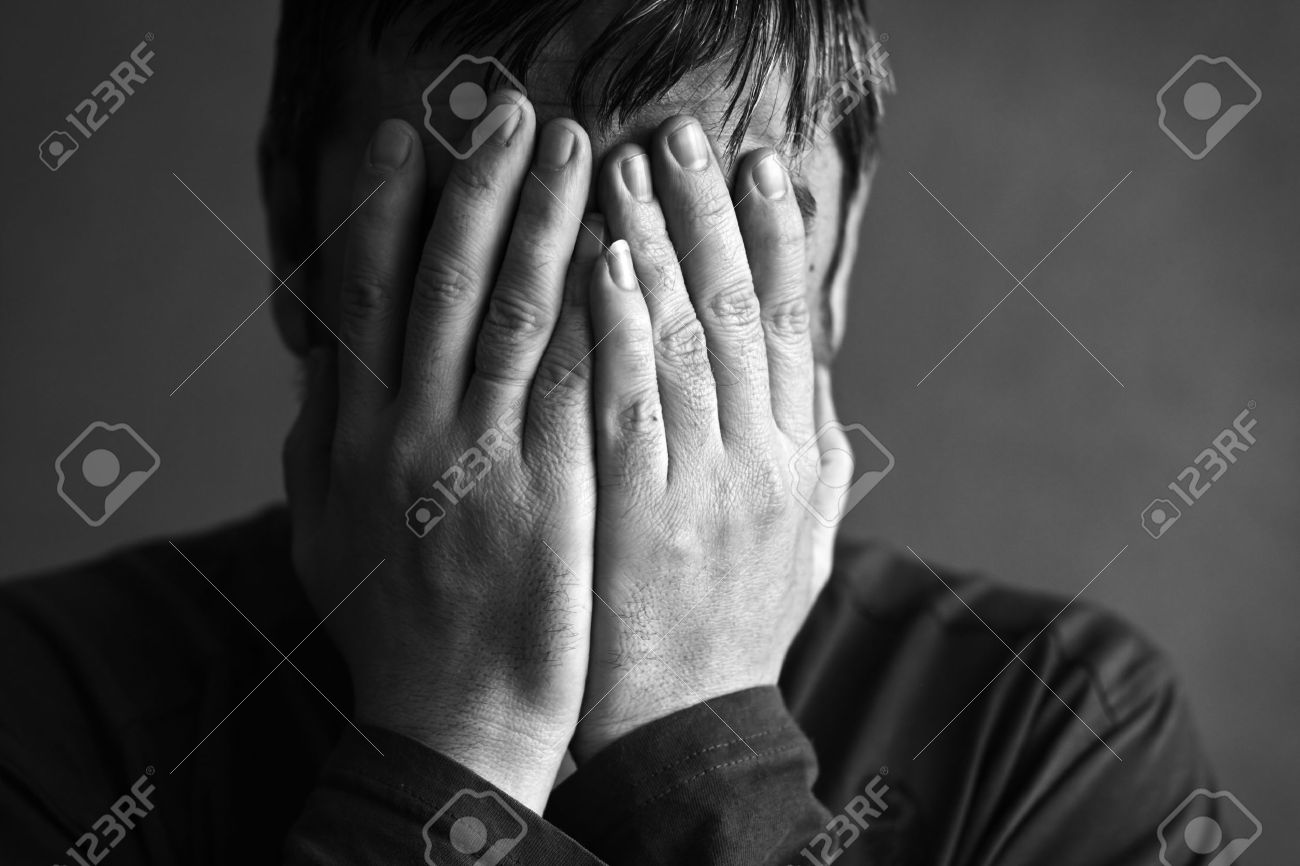 man covered his face with his hands Stock Photo - 10840542