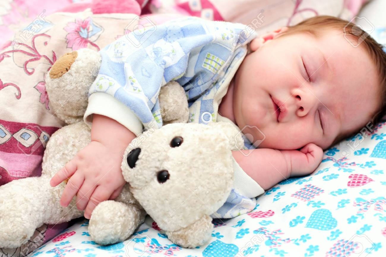 portrait of a sleeping baby with a toy Stock Photo - 10965745