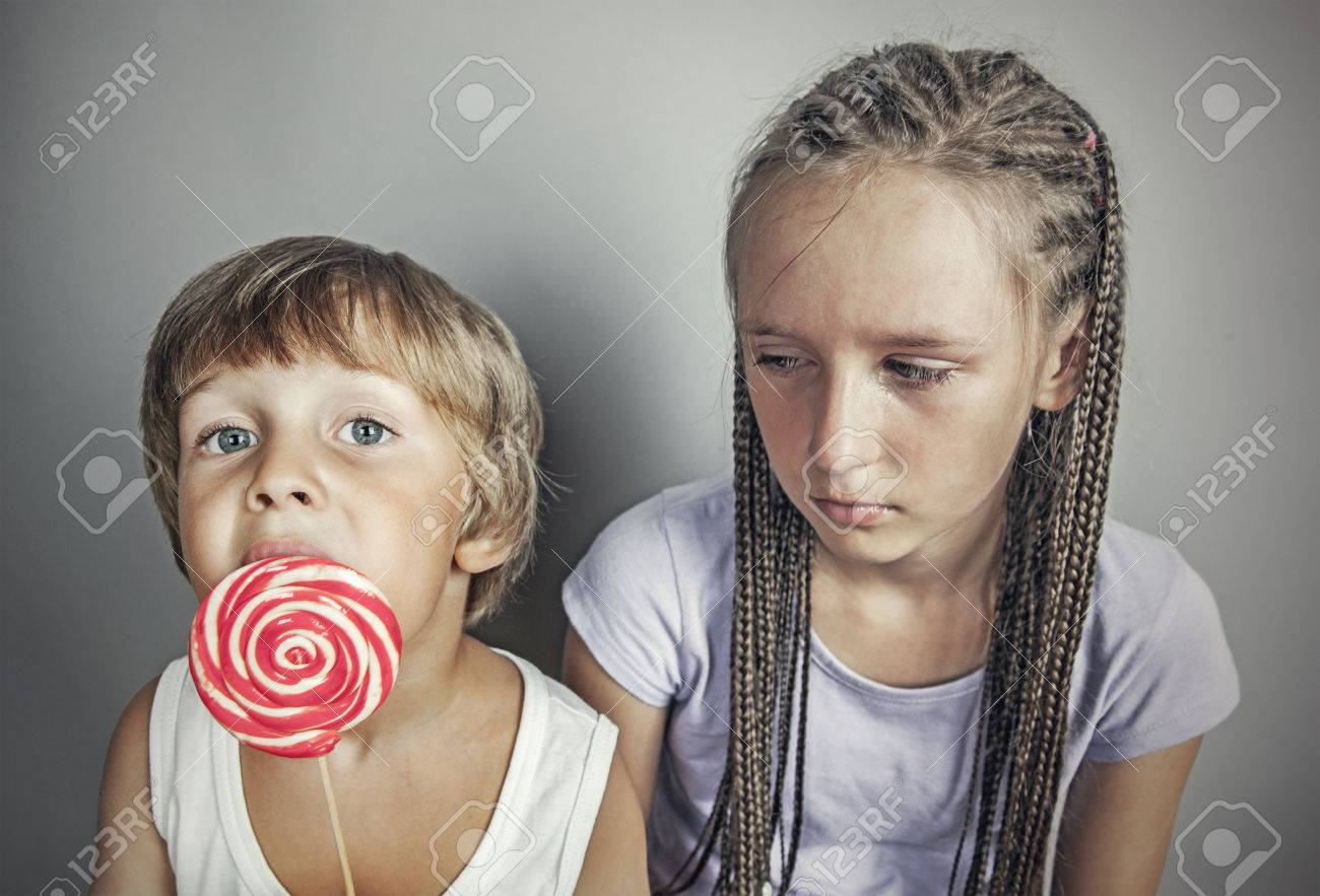Sister Jealous Brother Who Eats Candy Stock Photo