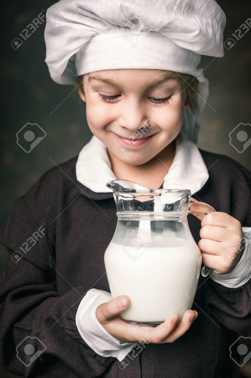 milkman boy holding a glass of milk Stock Photo - 39075743