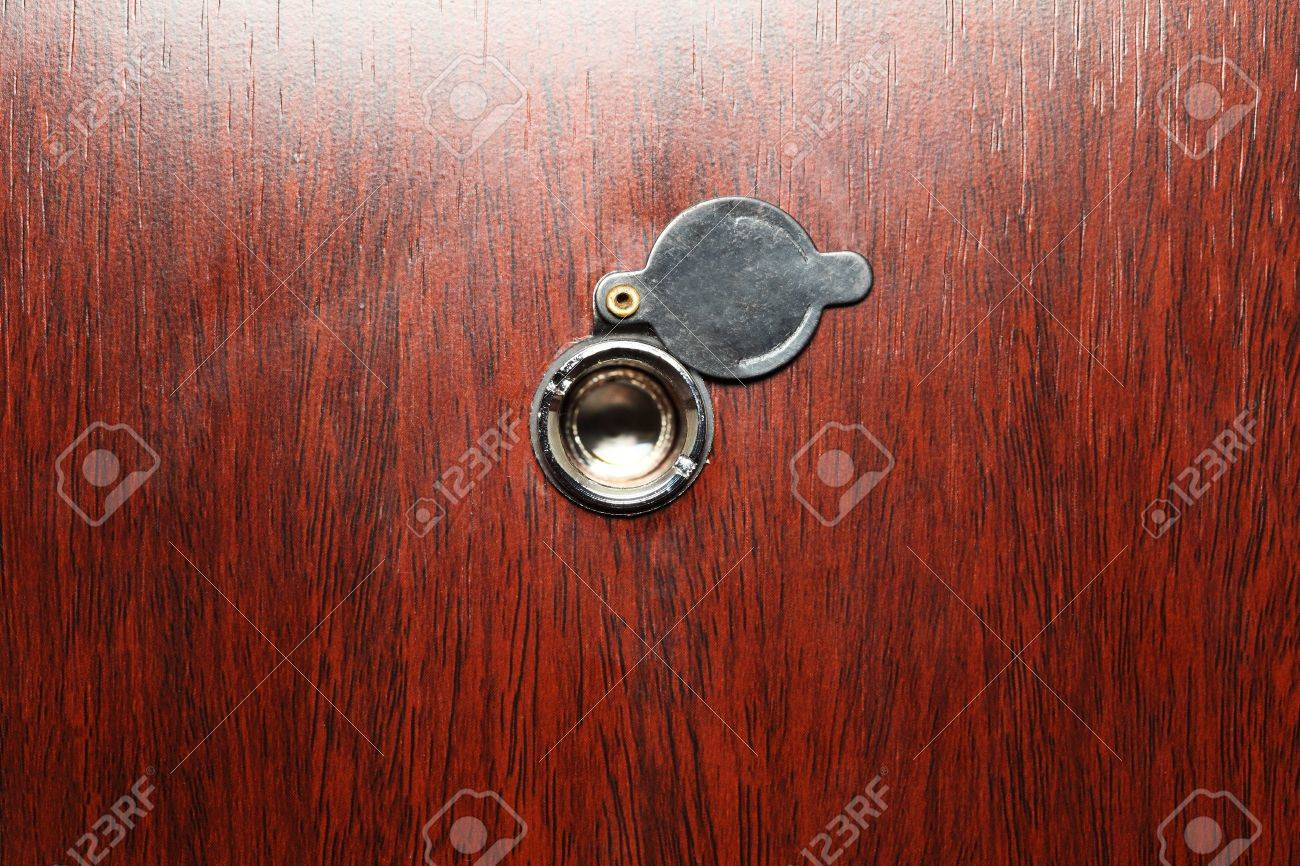 Peephole On Wooden Door   Judas Hole Spyhole Stock Photo   11567640