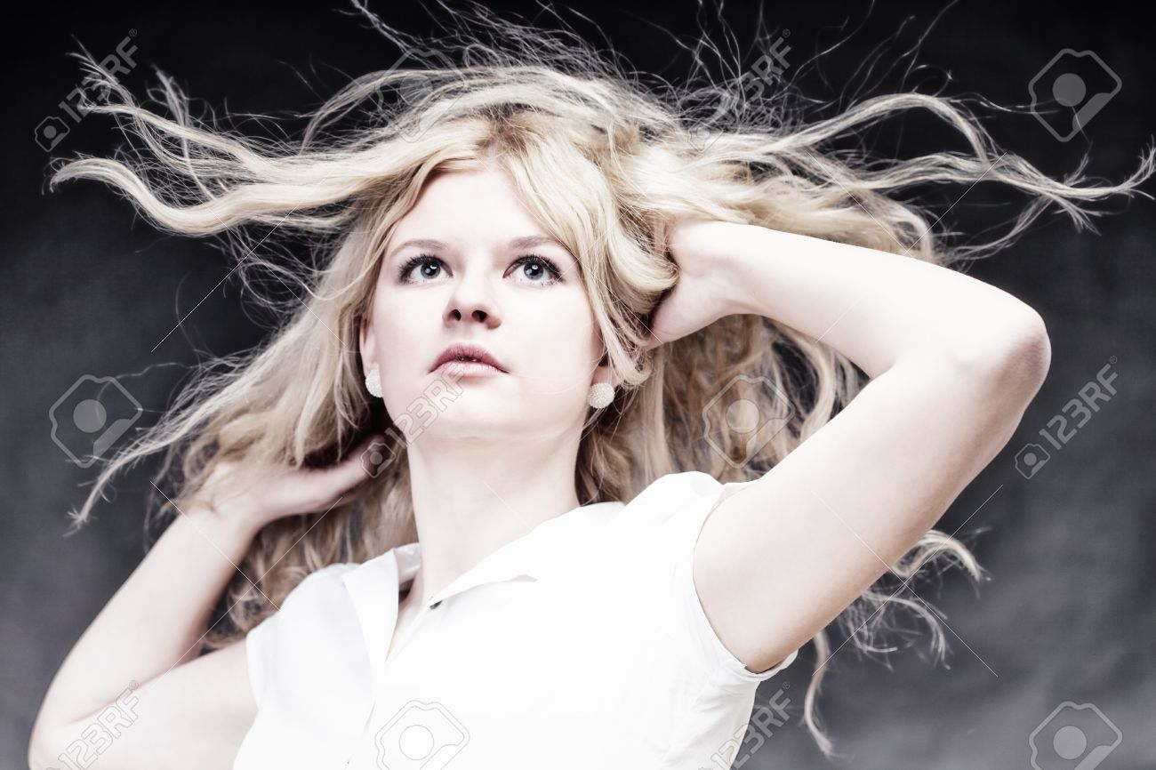 Blonde woman with her hair blowing in the wind Stock Photo - 11964763