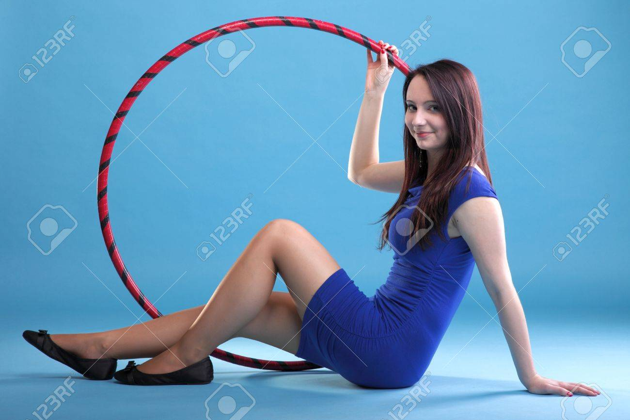 Beautiful woman in a sport wear. Dance hoop gym exercises blue background Stock Photo - 12269206