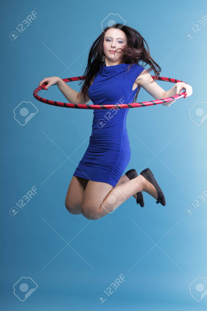 Beautiful woman in a sport wear. Dance hoop gym exercises blue background Stock Photo - 12920878