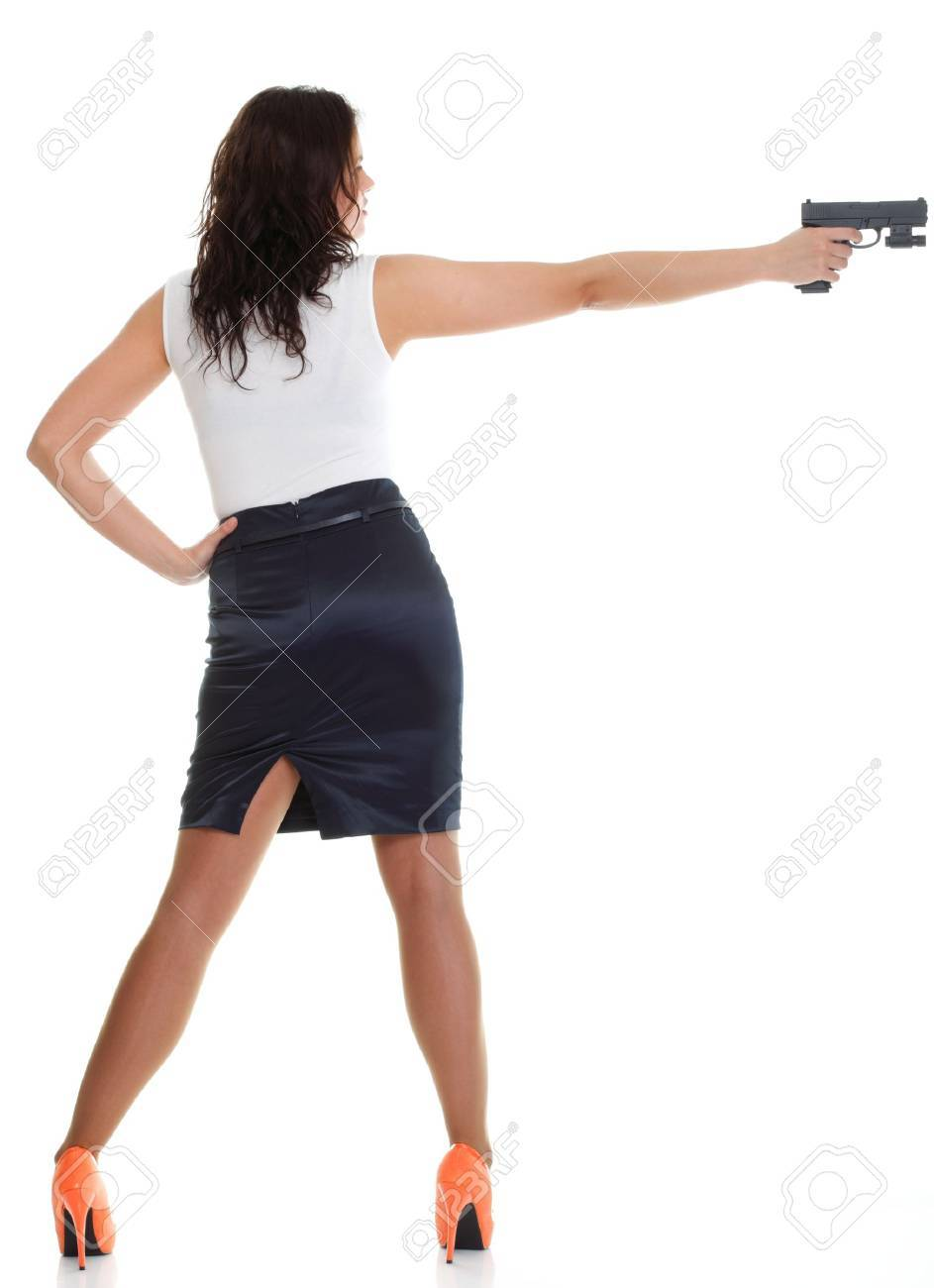 Young brunette woman with gun isolated on white full lengh Stock Photo - 13006488