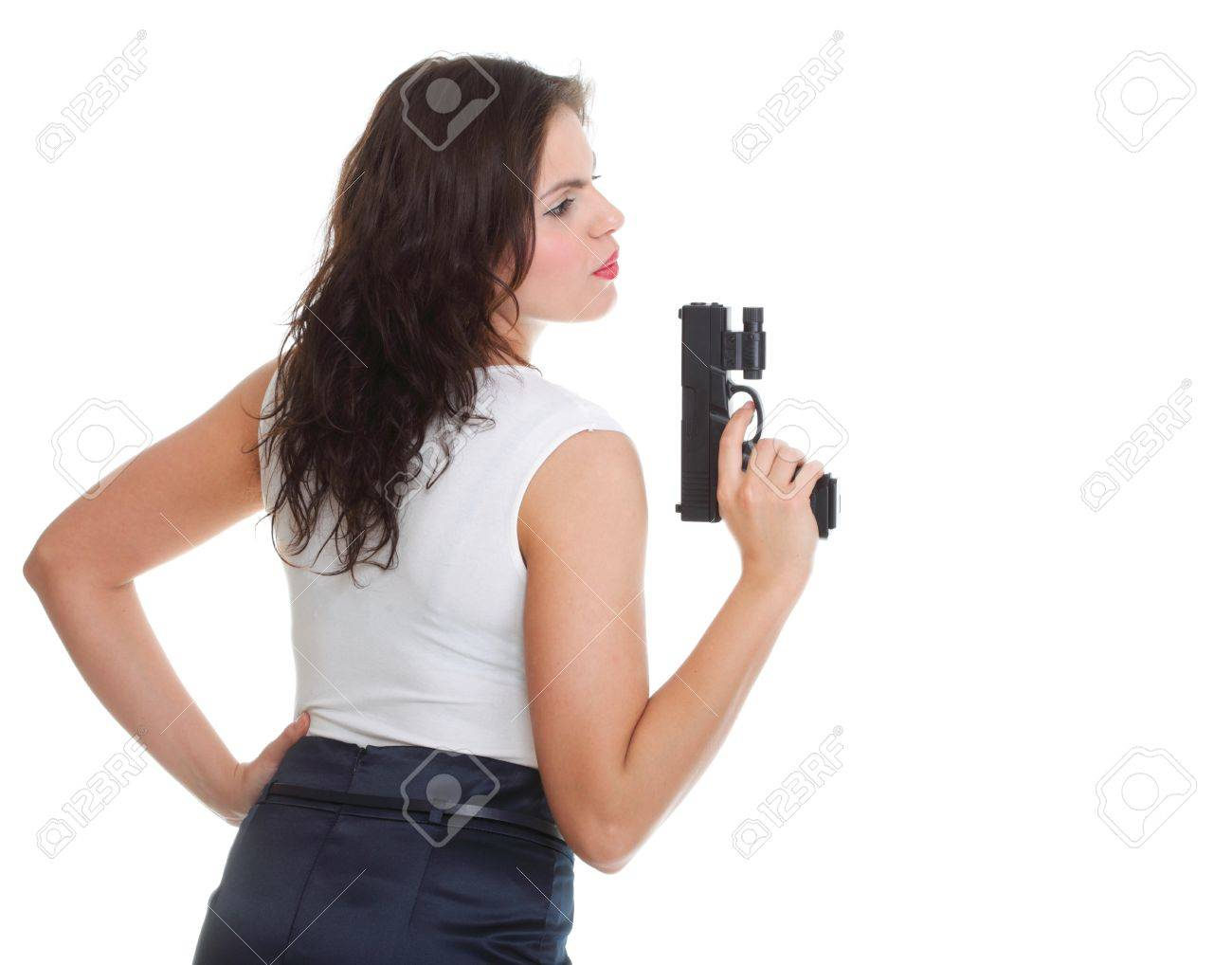 Young brunette woman with gun isolated on white Stock Photo - 12996767
