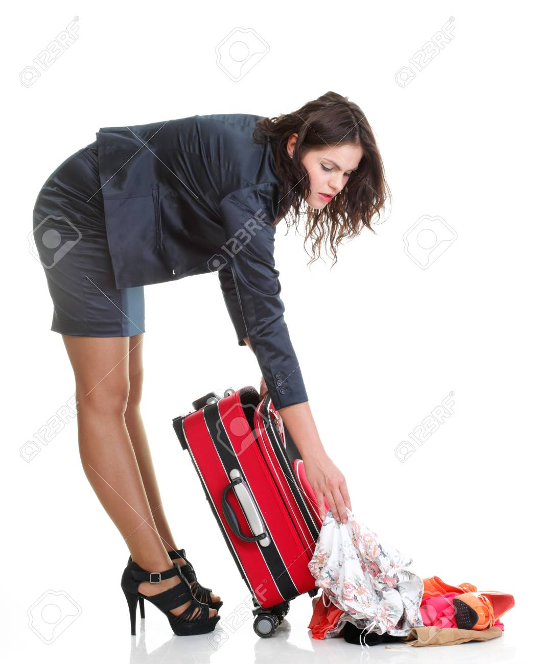 Full length of young business woman to late mishap misadventure pulling red travel bag clock isolated on white background Stock Photo - 13006551