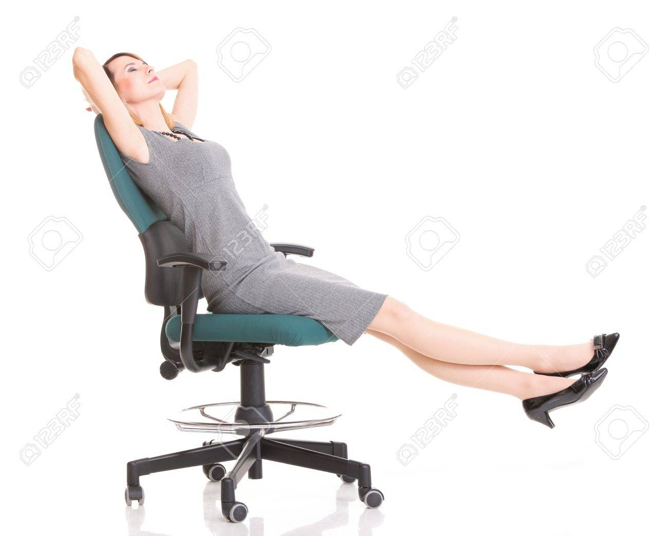 happy excited young businesswoman, relaxing in office chair, relax isolated on white Stock Photo - 13088861