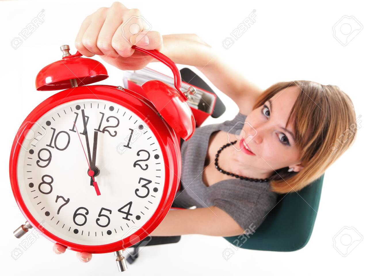 woman Overworked businesswoman holding plenty of documents isolated white red folder timeer time Stock Photo - 13088911