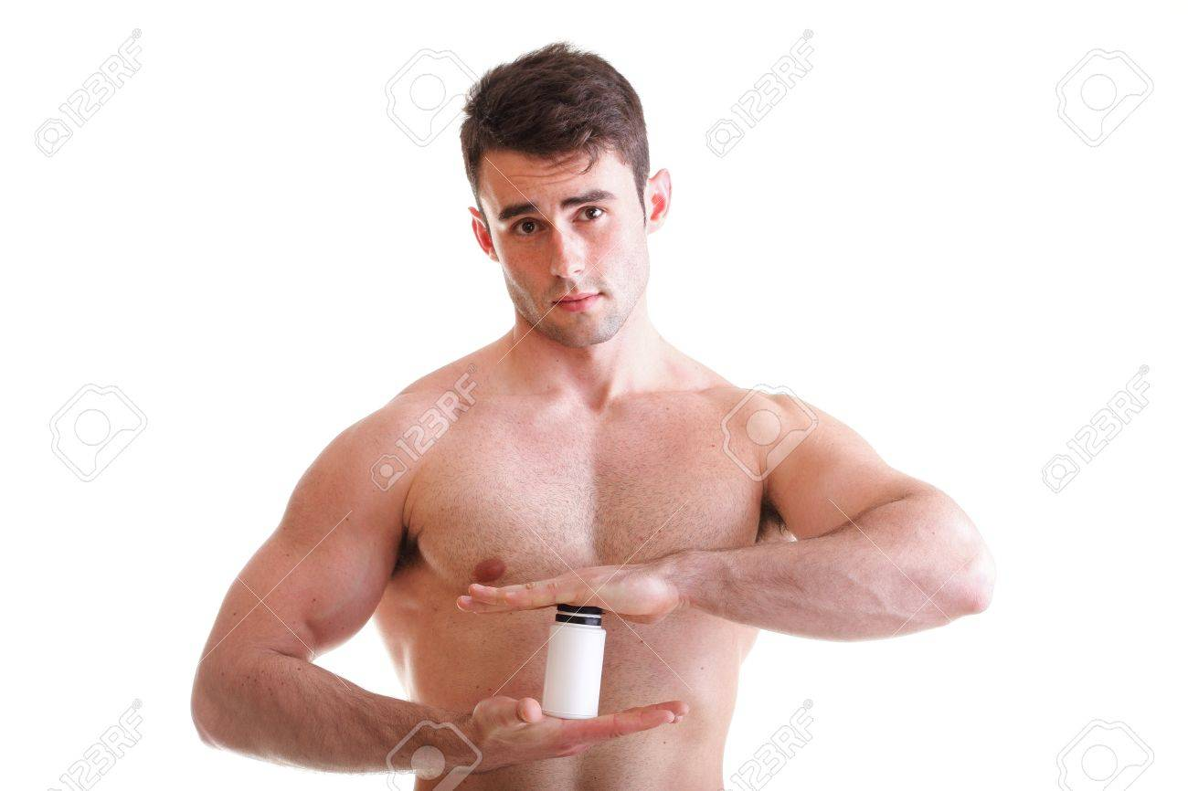 Athletic sexy male body builder holding a boxes with supplements on his biceps Stock Photo - 13088889