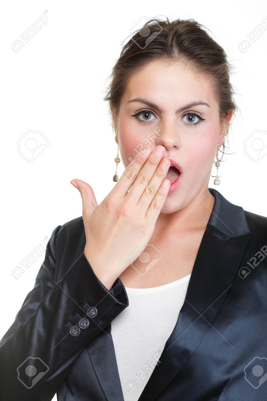 portrait of beautiful tired business woman stretching and yawning at her workplace isolated on white Stock Photo - 13187119