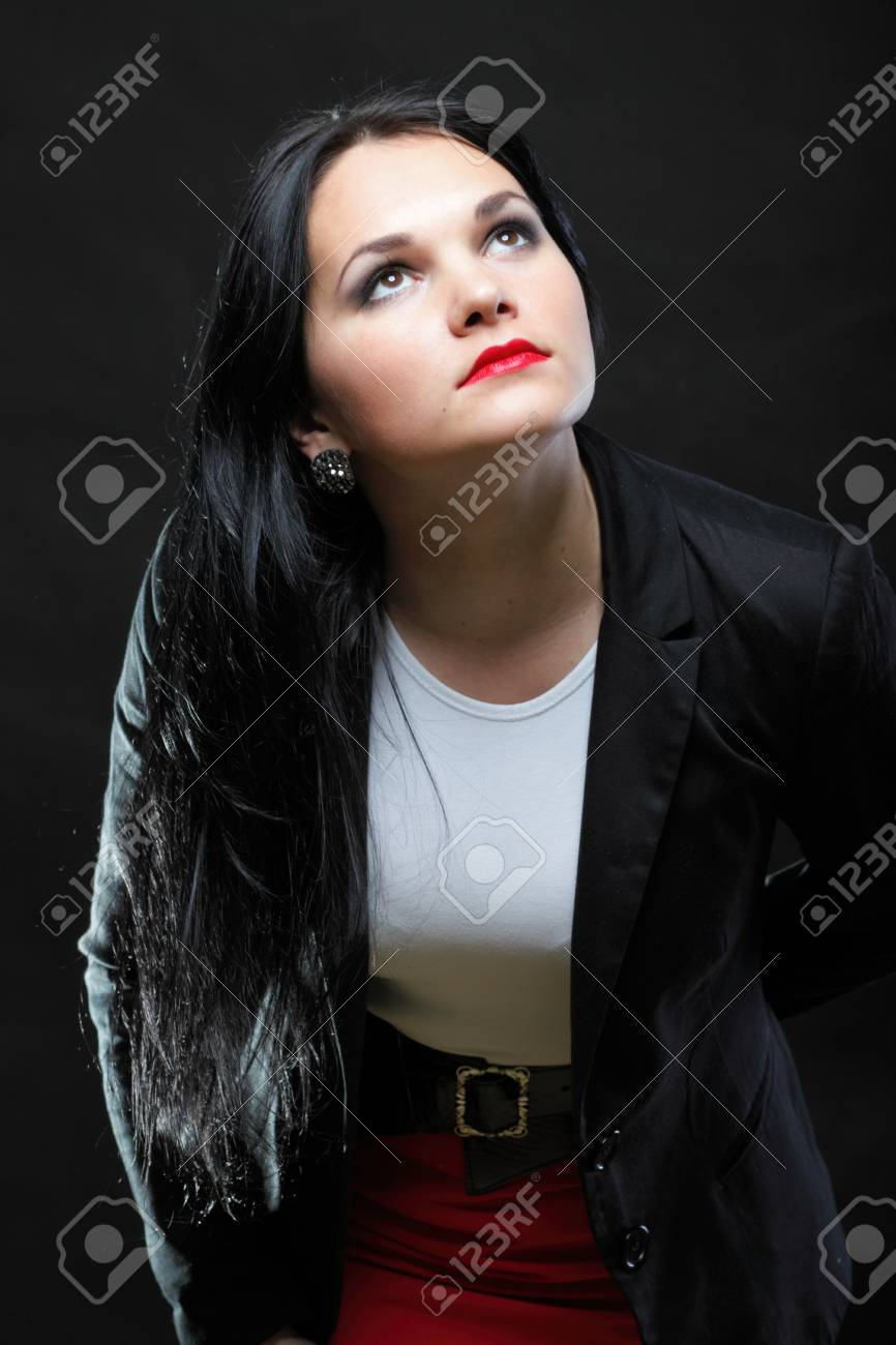 portrait of beautiful young brunette on black background. Stock Photo - 13382623