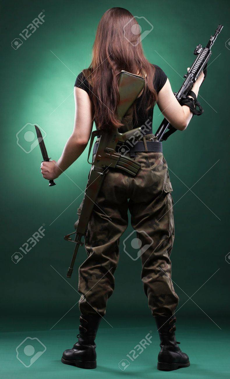 Beautiful woman with rifle plastic Military Army girl Holding Gun green background Stock Photo - 13382576