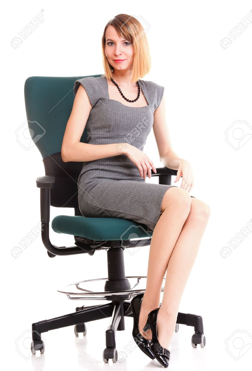 Full length of young business woman sitting on the chair over white background relaxing Stock Photo - 13570713