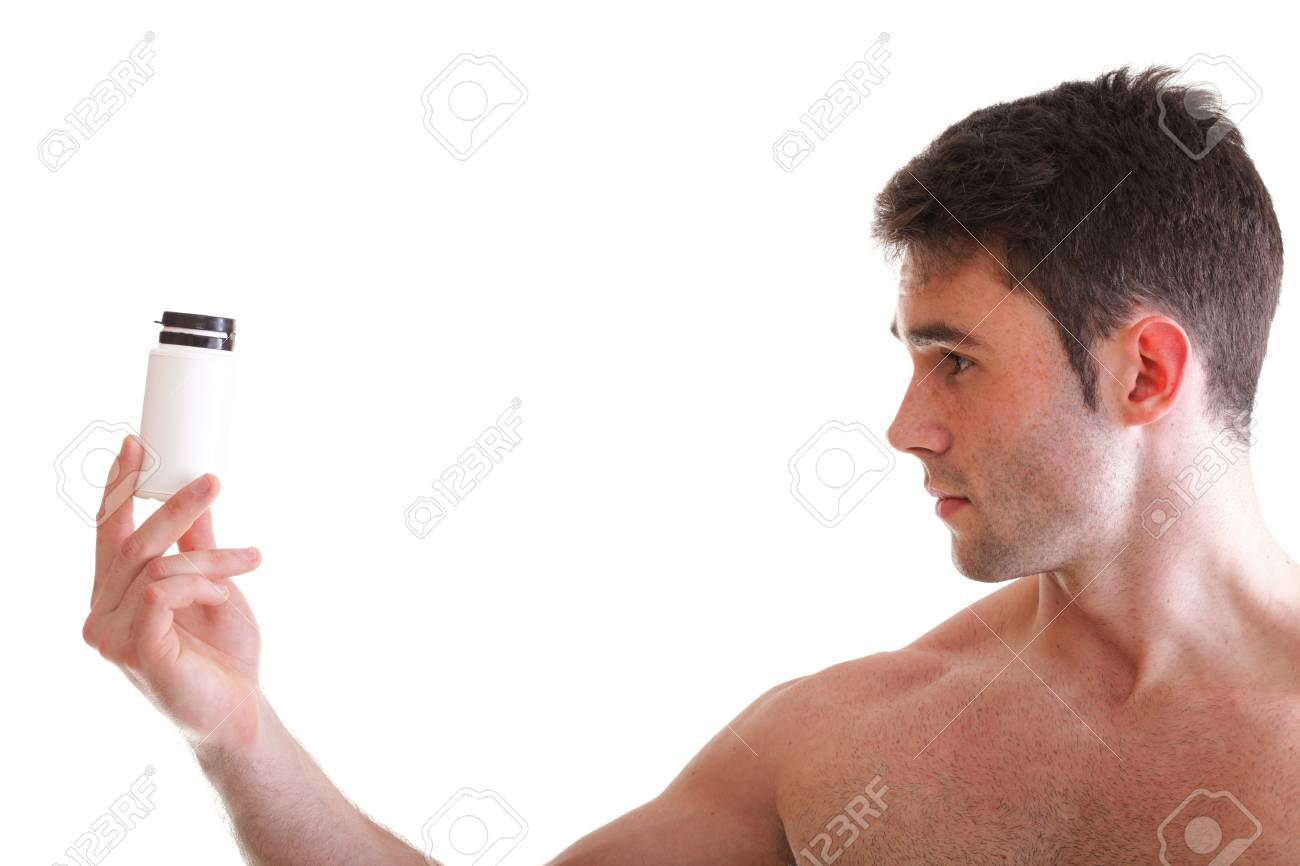 Athletic sexy male body builder holding a boxes with supplements on his biceps, man holding bottle of pills Stock Photo - 13570703