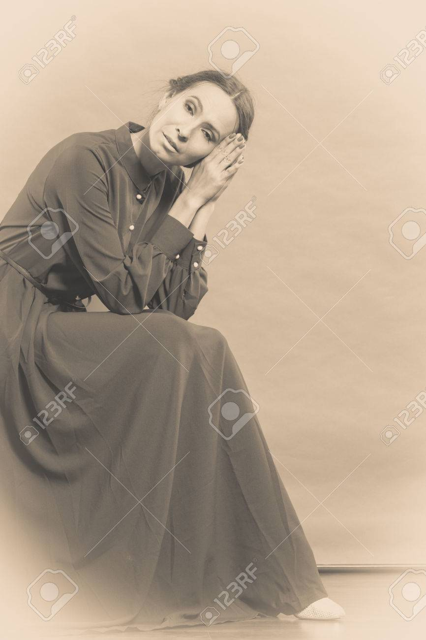 Sad Woman Retro Style Portrait Long Dark Gown Vintage Photo Sepia Toned Stock