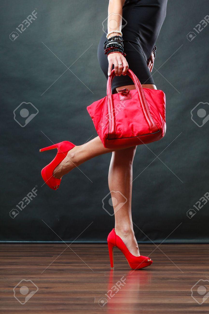 Black dress with red bag - Celebration Evening Fashion Concept Woman In Black Short Dress Red Spiked Shoes Holding Handbag Bag